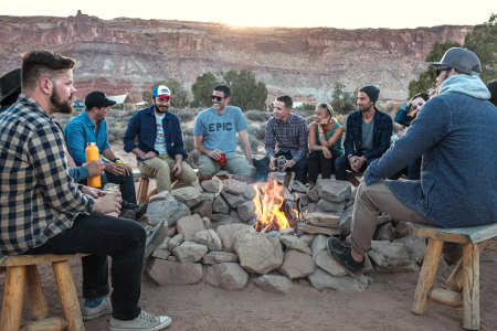 group talking over campfire